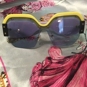 Oversized yellow and purple sunglasses